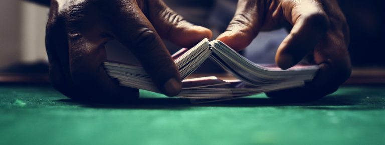 Dealer shuffling a deck of cards in casino