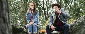 Backpackers drinking coffee or tea during hiking